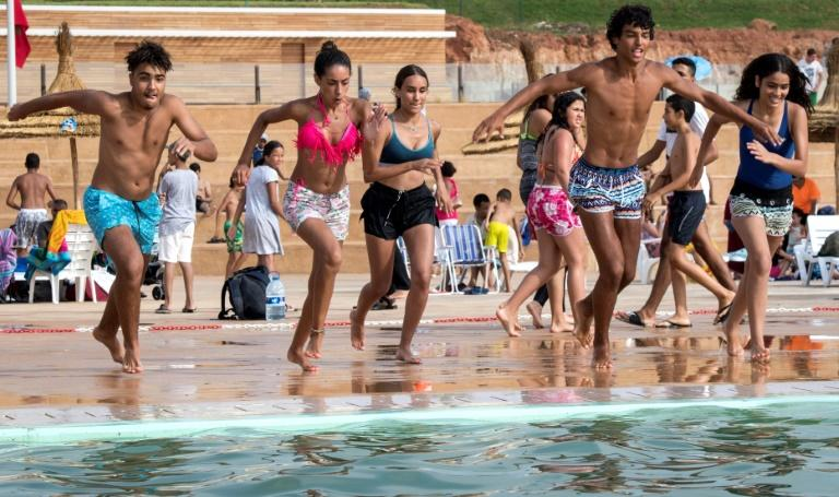 Thousands of Moroccans are flocking to the artificial pools carved into the rocky outcropping of the urban corniche in the capital Rabat