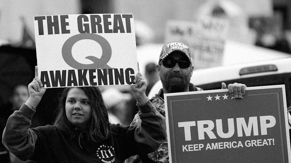 The Q-Anon conspiracy theorists  hold signs during the protest at the State Capitol in Salem, Oregon in May. (John Rudoff/Anadolu Agency via Getty Images)