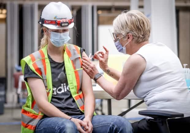 As of Friday, 44.8 per cent of eligible Albertans had received two doses of a COVID-19 vaccine.  (AHS - image credit)