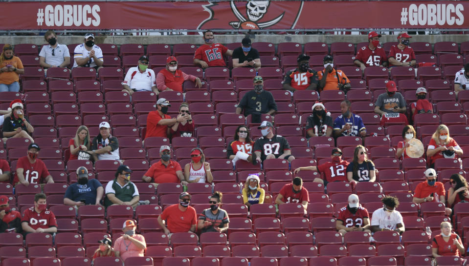 FILE - Socially distanced fans are shown during the second half of an NFL football game between the Minnesota Vikings and the Tampa Bay Buccaneers in Tampa, ion this Sunday, Dec. 13, 2020, file photo. Hall of Famer Warren Sapp wishes the Tampa Bay Buccaneers could pack the stands for the first Super Bowl played in a host team's home stadium. (AP Photo/Jason Behnken, FIle)
