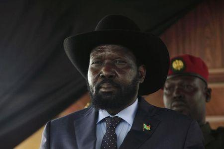 South Sudan's President Salva Kiir stands in front of the late Sudanese liberation hero John Garang's mausoleum at the 31st anniversary of the SPLA in Juba