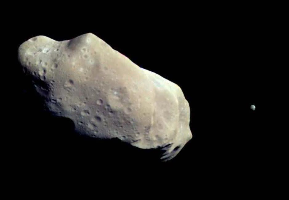 The Galileo spacecraft snapped this image of asteroid 243 Ida and its small moon Dactyl.