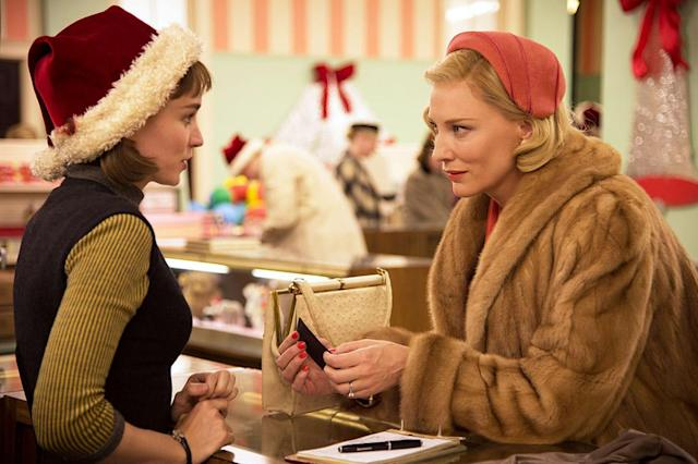 <p>Set in the winter of 1952, the love story between between glamorous older woman Carol (Cate Blanchett) and young photographer Therese (Rooney Mara) begins in a garland-decked department store and unfurls across a backdrop of holiday cheer: a crackling fireplace in Carol's tony New Jersey home, a gentle snowfall when Therese takes her first picture of Carol, and shabby decorations in the lobbies of motels when the women escape the city together. Their hard-earned happy ending takes place after New Year's Day, but at Carol's warmly lit table in the Oak Room, it still feels like Christmas.—<em>G.W. </em>(Available on Netflix)<br><em>(Photo: Weinstein Company/courtesy Everett Collection)</em> </p>