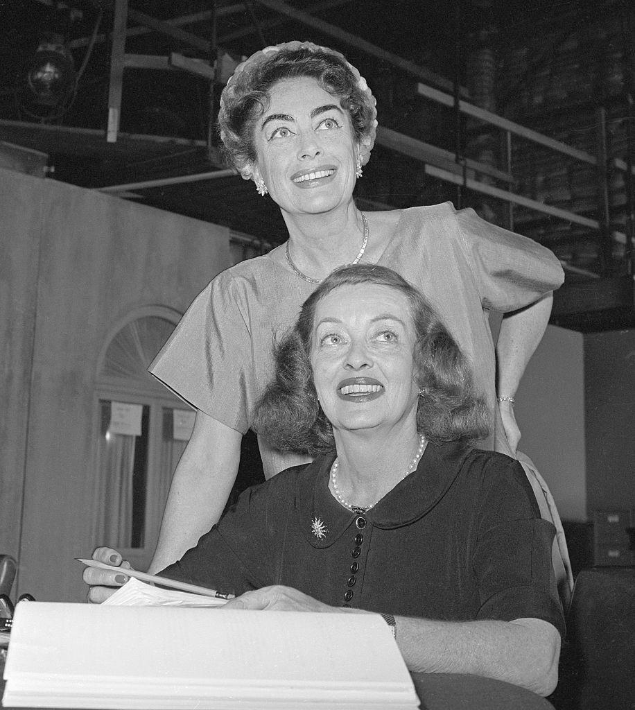 """<p>How could we not start with one of Hollywood's most legendary feuds of all? Joan Crawford and Bette Davis' feud was so infamous that it even <a href=""""https://www.harpersbazaar.com/culture/film-tv/a20666/feud-bette-davis-joan-crawford-timeline/"""" rel=""""nofollow noopener"""" target=""""_blank"""" data-ylk=""""slk:inspired an FX show called Feud"""" class=""""link rapid-noclick-resp"""">inspired an FX show called <em>Feud</em></a>. The rivalry between the two silver-screen actresses reportedly began in 1935 over a man, when Bette fell in love with her co-star, Franchot Tone, on the set of the movie """"Dangerous"""" — only for Joan to quickly marry him shortly after the film was wrapped. </p>"""
