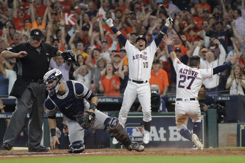 Houston Astros' Jose Altuve reacts after scoring the game-winning run past New York Yankees catcher Gary Sanchez during the ninth inning of Game 2 of baseball's American League Championship Series Saturday, Oct. 14, 2017, in Houston. (AP)