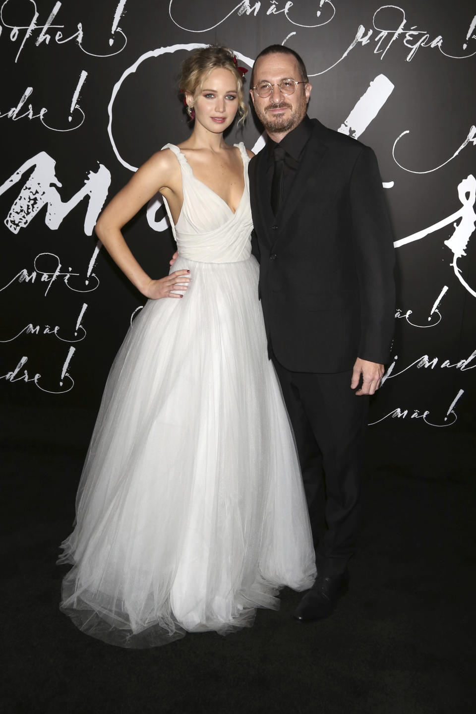 Jennifer Lawrence and boyfriend Darren Aronofsky pose together at the NY premiere of 'mother!'.