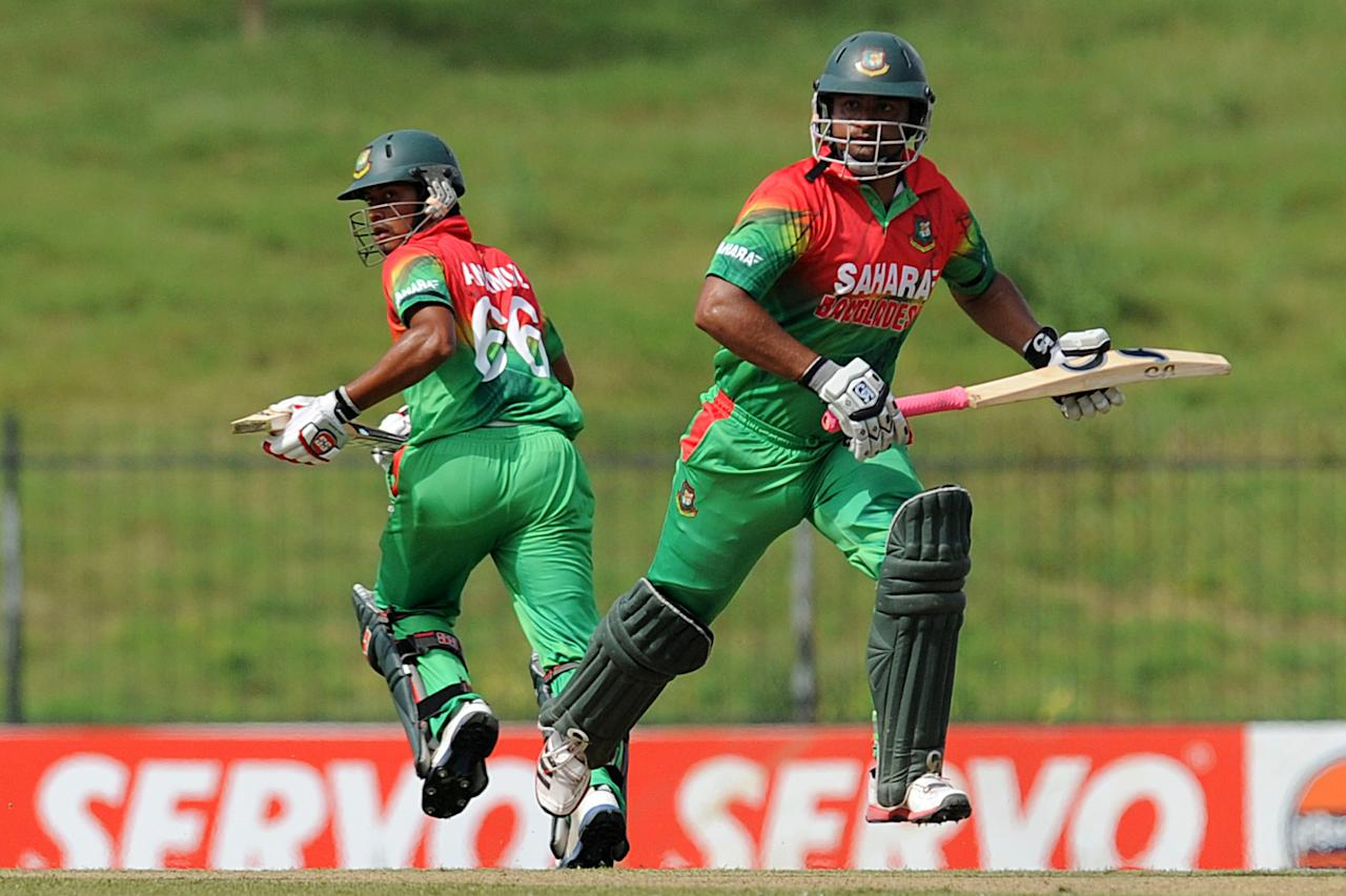 Bangladeshi cricketers Anamul Haque (L) and Tamim Iqbal run between the wickets during the opening one-day international (ODI) match between Sri Lanka and Bangladesh at The Suriyawewa Mahinda Rajapakse International Cricket Stadium in the southern district of Hambantota on March 23, 2013. Sri Lankan cricket captain Angelo Mathews won the toss and elected to field. AFP PHOTO/ Ishara S. KODIKARA (Photo credit should read Ishara S.KODIKARA/AFP/Getty Images)