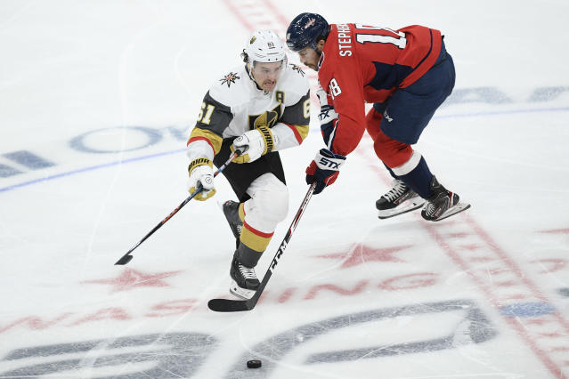 Vegas Golden Knights right wing Mark Stone (61) and Washington Capitals center Chandler Stephenson (18) chase the puck during the third period of an NHL hockey game, Saturday, Nov. 9, 2019, in Washington. (AP Photo/Nick Wass)