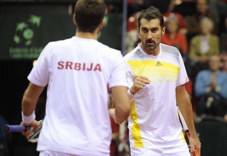 Serbia's Viktor Troicki (L) and Nenad Zimonjic during their Davis Cup match against Belgian pair Steve Darcis and Ruben Bemelmans on February 2, 2013. Troicki and Zimonjic won 6-4, 6-4, 5-7, 6-4 to secure a 3-0 win over Belgium