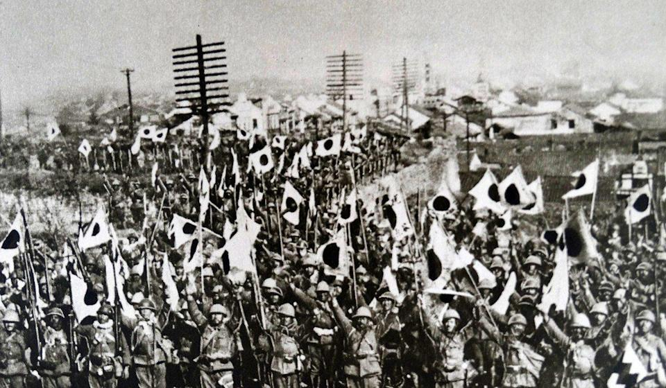A photo print dated 1937, showing Japanese troops in Nanking after the city's conquest. Photo: Getty Images