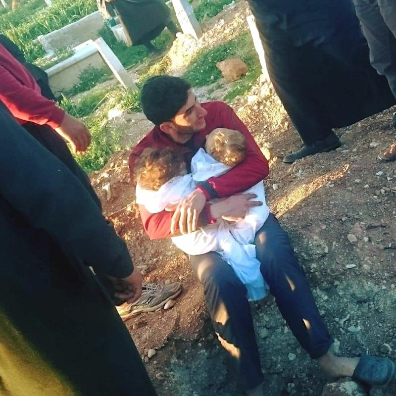 Abdulhamid Yussef cradles his twins Aya and Ahmad before they are buried in Idlib following a Sarin gas attack - Alaa al-Youssef Sourced by Josie Ensor