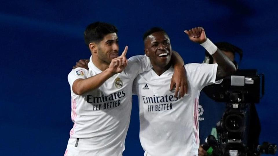 Vinicius y Asensio | PIERRE-PHILIPPE MARCOU/Getty Images