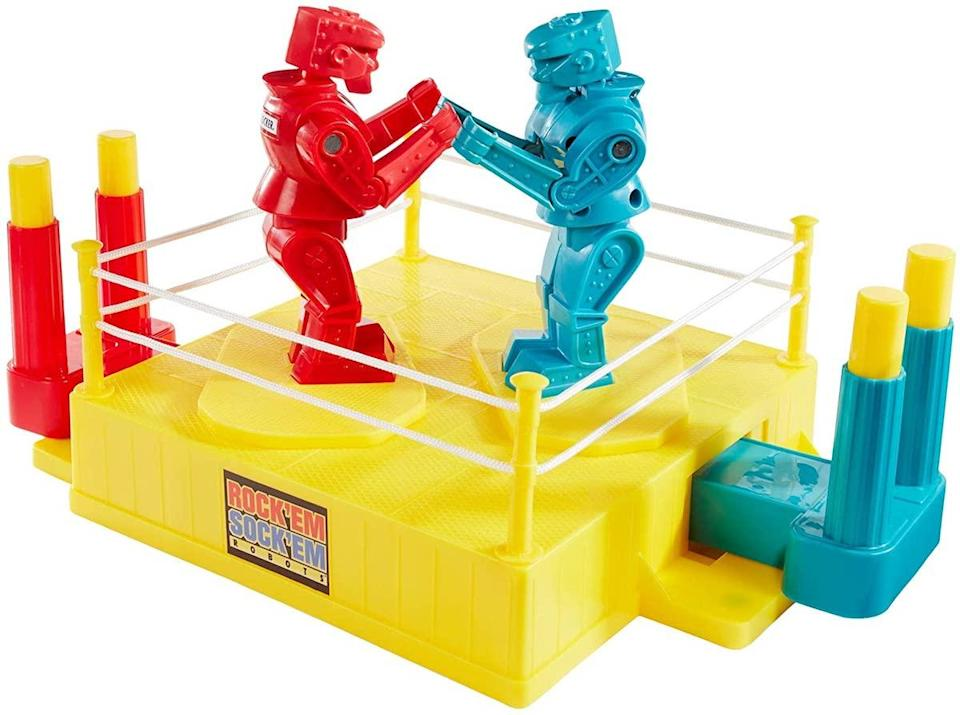 Mattel's classic Rock 'Em sock 'Em robots game, with a yellow ring and blue and red boxers
