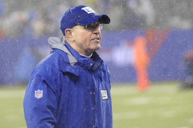 New York Giants coach Tom Coughlin leaves the field after an NFL football game against the Washington Redskins Sunday, Dec. 29, 2013, in East Rutherford, N.J. The Giants won the game 20-6. (AP Photo/Bill Kostroun)