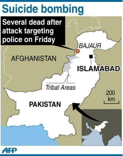 A teenage suicide bomber targeted police in a bustling Pakistan town square on Friday, killing at least 24 people and wounding dozens in the tribal area near the Afghan border, officials said
