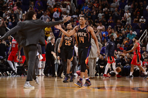 PHOENIX, AZ - APRIL 5: De'Anthony Melton #14 of the Phoenix Suns and Kelly Oubre Jr. #3 of the Phoenix Suns celebrate during the game against the New Orleans Pelicans on April 5, 2019 at Talking Stick Resort Arena in Phoenix, Arizona. (Photo by Barry Gossage/NBAE via Getty Images)