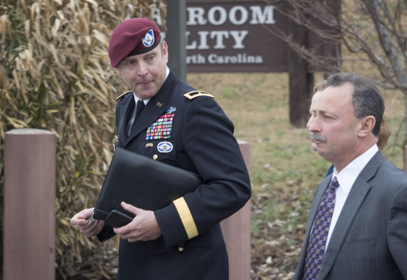 Brig. Gen. Jeffrey Sinclair, left, leaves the Fort Bragg courthouse, Monday, March 17, 2014 with his defense attorney Richard Scheff. Sinclair, who admitted to improper relationships with three subordinates appeared to choke up as he told a judge that he'd failed the female captain who had leveled the most serious accusations against him. (AP Photo/The Fayetteville Observer, Johnny Horne)
