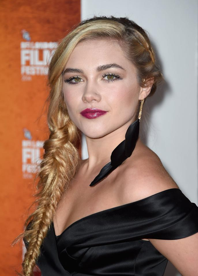 <p>Pugh looked like Rapunzel with her ethereal-looking, messy side braid at the 58th BFI London Film Festival in 2014. She emphasized the hairstyle with a dramatic wine-colored lip and defined eyelashes.</p>