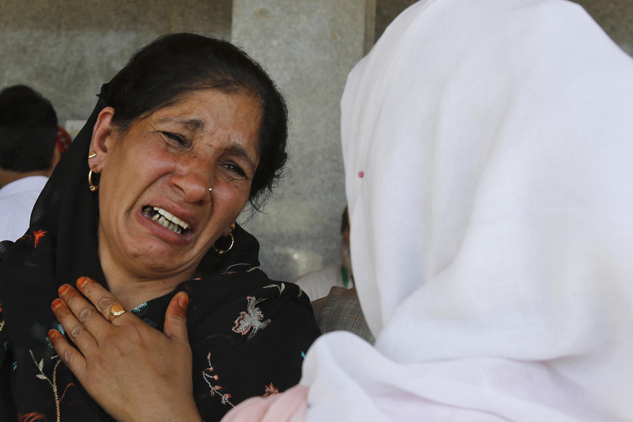 An unidentified Kashmiri woman cries as others carry the body of an elderly Kashmiri civilian Ghulam Mohammad Mir, who succumbed to injury allegedly attained during a protest last week, outside a hospital in Srinagar, India, Wednesday, July 20, 2016. The largest street protests in recent years in the disputed region, that left dozens of people dead and hundreds injured erupted more than a week ago after Indian troops killed a popular young rebel leader. (AP Photo/Mukhtar Khan)