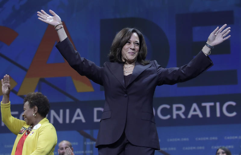 Democratic presidential candidate Sen. Kamala Harris, D-Calif., gestures in front of Congresswoman Barbara Lee before speaking during the 2019 California Democratic Party State Organizing Convention in San Francisco, Saturday, June 1, 2019. (AP Photo/Jeff Chiu)