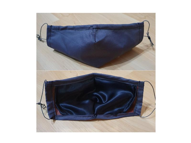 This blue silk mask has a soft cotton outer layerEtsy