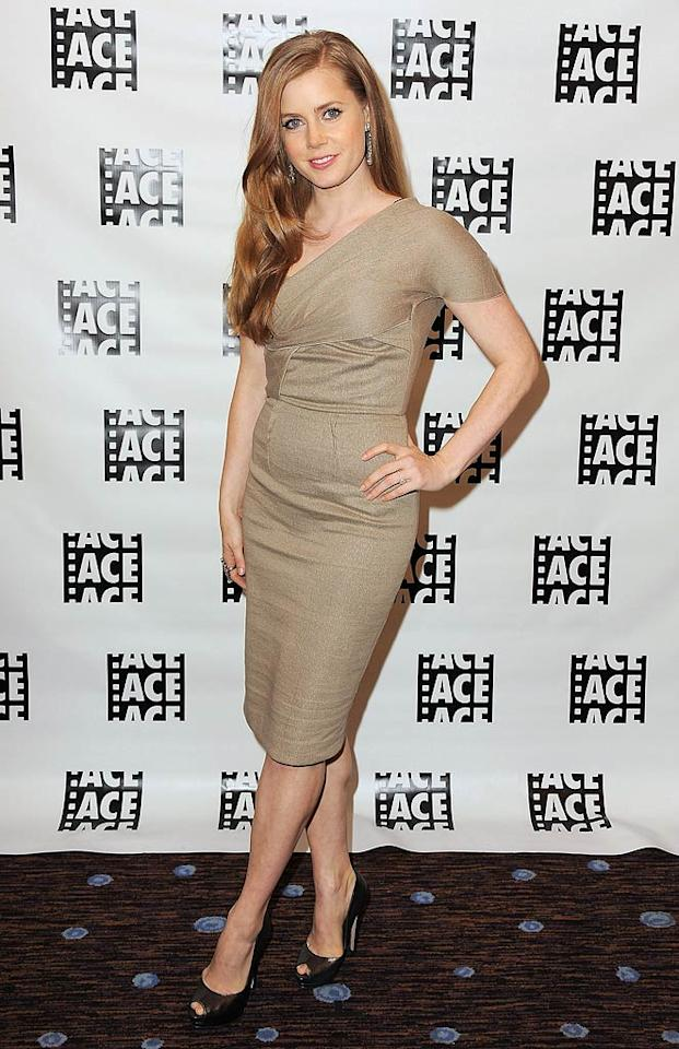 "Oscar nominee Amy Adams put her best foot forward as she arrived at the 61st Annual ACE Eddie Awards in a ravishing Roland Mouret ""Hermia"" dress, freshly colored locks, and black peep-toes. Jordan Strauss/<a href=""http://www.wireimage.com"" target=""new"">WireImage.com</a> - February 19, 2011"