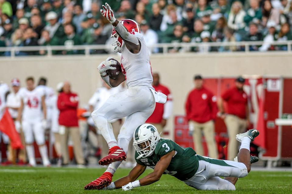 Michigan State's Xavier Henderson, right, tackles Indiana's Stevie Scott III during the third quarter on Saturday, Sept. 28, 2019, in East Lansing.