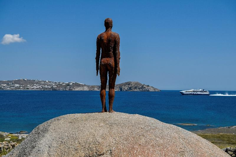 'Another time XV', by Antony Gormley, standing at the entrance to the small island of Delos, looking across to Mykonos (AFP Photo/LOUISA GOULIAMAKI)