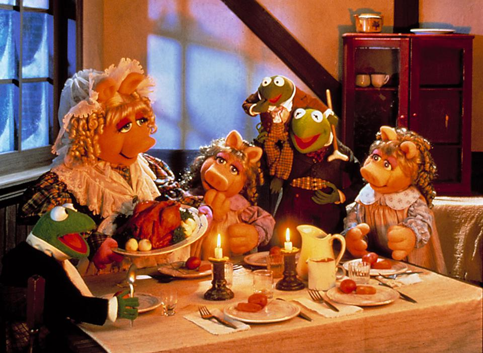 No humbuggery here: Miss Piggy, Kermit, and the gang sing the praises of Xmas  in the Muppet Christmas Carol. (Photo: Disney)