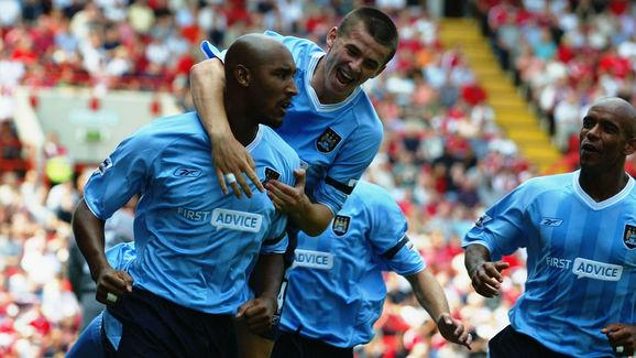 Nicolas Anelka of Manchester City celebrates scoring the opening goal with team-mate Joey Barton