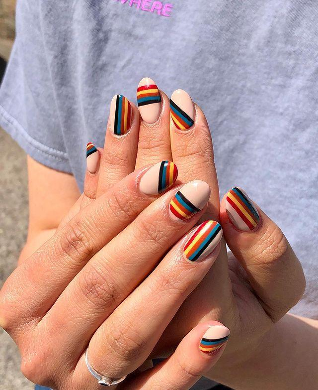 "<p>Part Paul Smith, part fizzy rainbow sweets, this summer nail art is the ultimate high-low mash-up.</p><p><a href=""https://www.instagram.com/p/Byh0JPLl42d/"" rel=""nofollow noopener"" target=""_blank"" data-ylk=""slk:See the original post on Instagram"" class=""link rapid-noclick-resp"">See the original post on Instagram</a></p>"