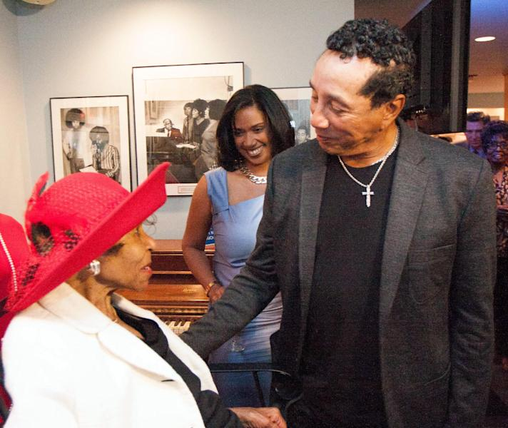 """In this photo provided by the Motown Museum, Smokey Robinson, right, speaks to Maxine Powell, left, during an event held in her honor Monday, Aug. 26, 2013, at the Motown Museum in Detroit. Powell directed the label's Artists Development Department, also known as """"Motown's Finishing School."""" She guided many, including Robinson's Miracles, the Jackson Five and the Supremes. (AP Photo/Motown Museum, Andre Smith)"""