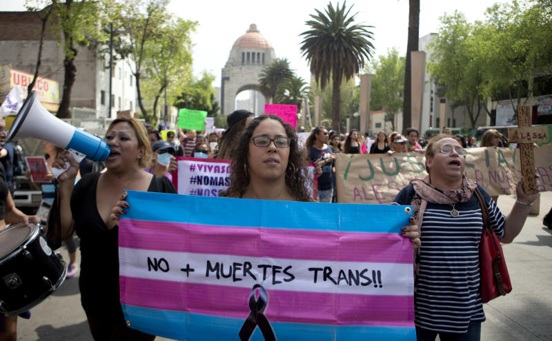 """A demonstrator holds a flag that says in Spanish """"No more trans deaths!"""" to protest violence against the transgender community in Mexico City, Thursday, Oct. 20, 2016. Protesters denounced the murders of several transgender people who were killed last week in Mexico City. (AP Photo/Eduardo Verdugo)"""