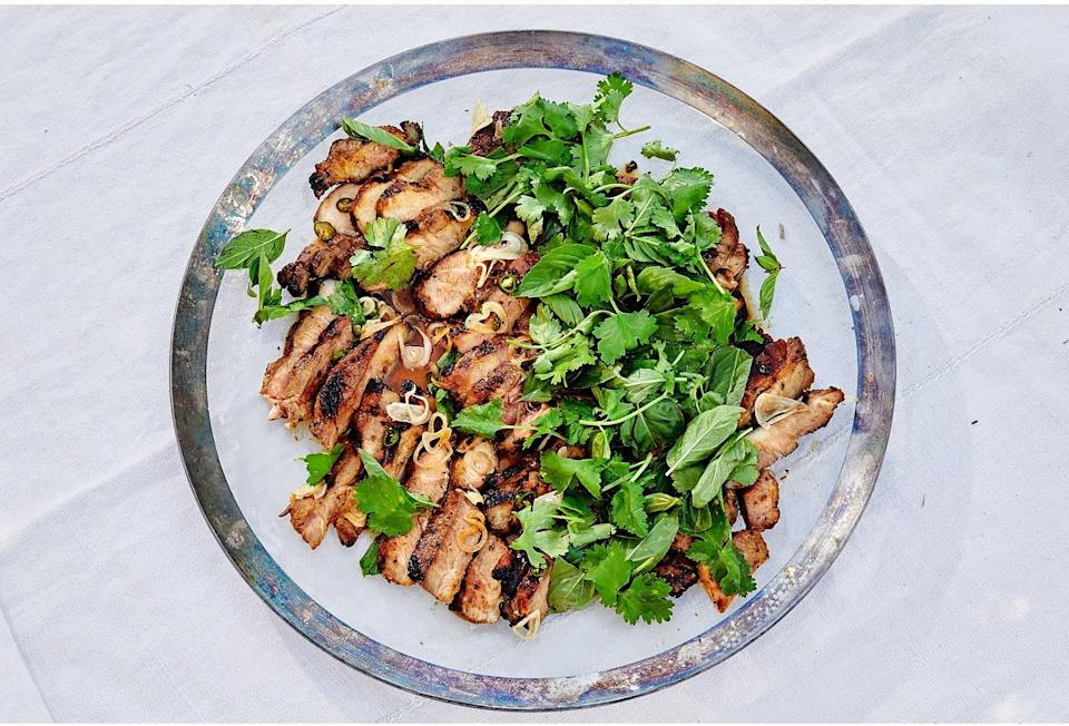 """Depending on your schedule, you can toss these pork steaks in their marinade—a flavorful blend of fish sauce, lime juice, and garlic and shallots—an hour before grilling or up to 12 hours ahead of time. When you're doing the grilling, don't go for perfect char marks: You want to flip these often, so the fat renders easily without overcooking the meat. <a href=""""https://www.epicurious.com/recipes/food/views/grilled-pork-shoulder-steaks-with-herb-salad?mbid=synd_yahoo_rss"""" rel=""""nofollow noopener"""" target=""""_blank"""" data-ylk=""""slk:See recipe."""" class=""""link rapid-noclick-resp"""">See recipe.</a>"""