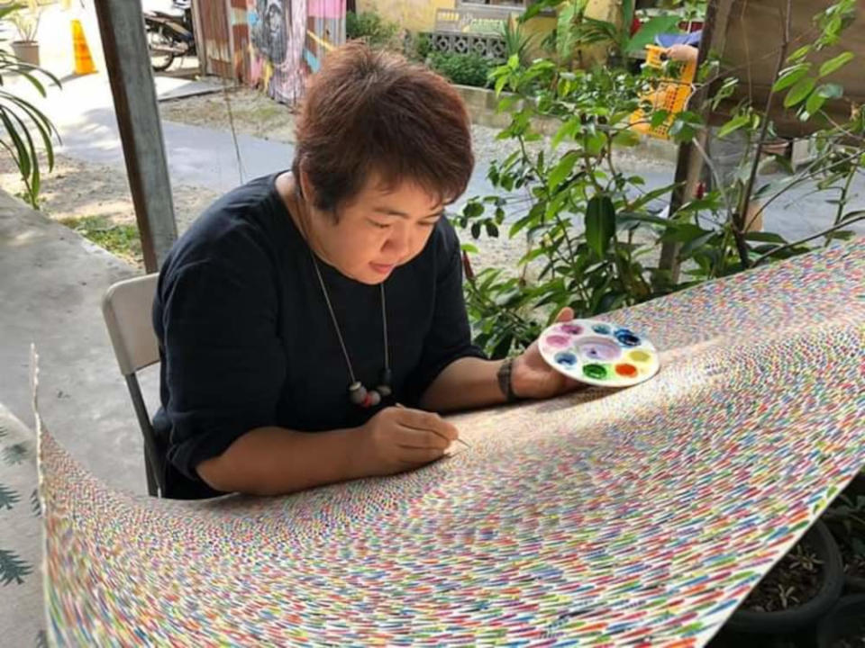 Queen Lee working on her watercolour painting. — Picture courtesy of Queen Lee
