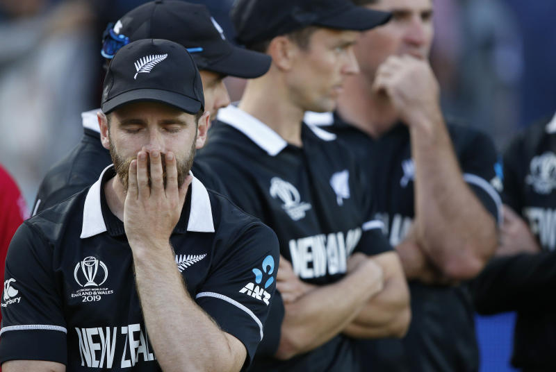New Zealand's captain Kane Williamson reacts as he waits for the trophy presentation after losing the Cricket World Cup final match between England and New Zealand at Lord's cricket ground in London, Sunday, July 14, 2019. England won after a super over after the scores ended tied after 50 overs each. (AP Photo/Matt Dunham)