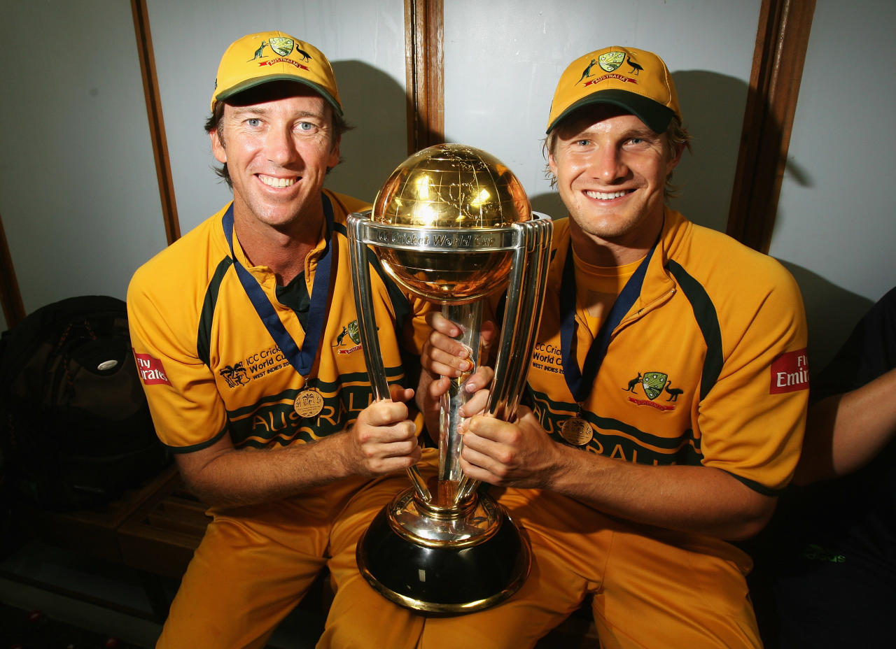 BRIDGETOWN, BARBADOS - APRIL 28:  Glenn McGrath and Shane Watson of Australia pose with the ICC World Cup trophy in the changing rooms after Australia defeated Sri Lanka during the ICC Cricket World Cup Final between Australia and Sri Lanka at the Kensington Oval on April 28, 2007 in Bridgetown, Barbados.  (Photo by Hamish Blair/Getty Images)