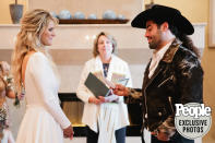 "<p>Dianne Krus — whom Wayne called Moody's ""guardian angel"" throughout his 11 years in Nashville — married the couple, who wrote their own vows.</p>"
