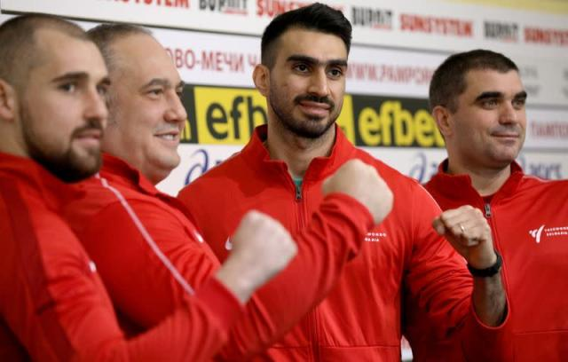 Iranian taekwondo competitor Farzad Zolghadri and the head of Bulgarian Taekwondo Federation Slavi Binev pose for pictures after attending a news conference at Vasil Levski stadium in Sofia