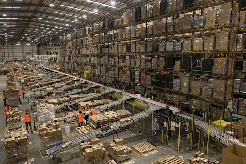 Embargoed to 2359 Wednesday November 15 Parcels are processed and prepared for dispatch at Amazon's Fulfilment Centre at Kingston Park in Peterborough as the online retailer prepares for Black Friday.