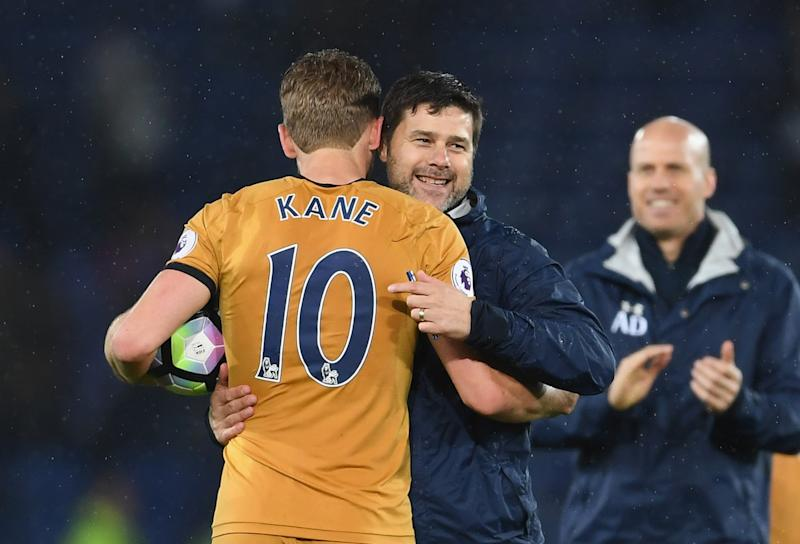 LEICESTER, ENGLAND - MAY 18: Harry Kane of Tottenham Hotspur holds the match ball as he celebrates scoring four goals with Mauricio Pochettino manager of Tottenham Hotspur after the Premier League match between Leicester City and Tottenham Hotspur at The King Power Stadium on May 18, 2017 in Leicester, England. (Photo by Laurence Griffiths/Getty Images)