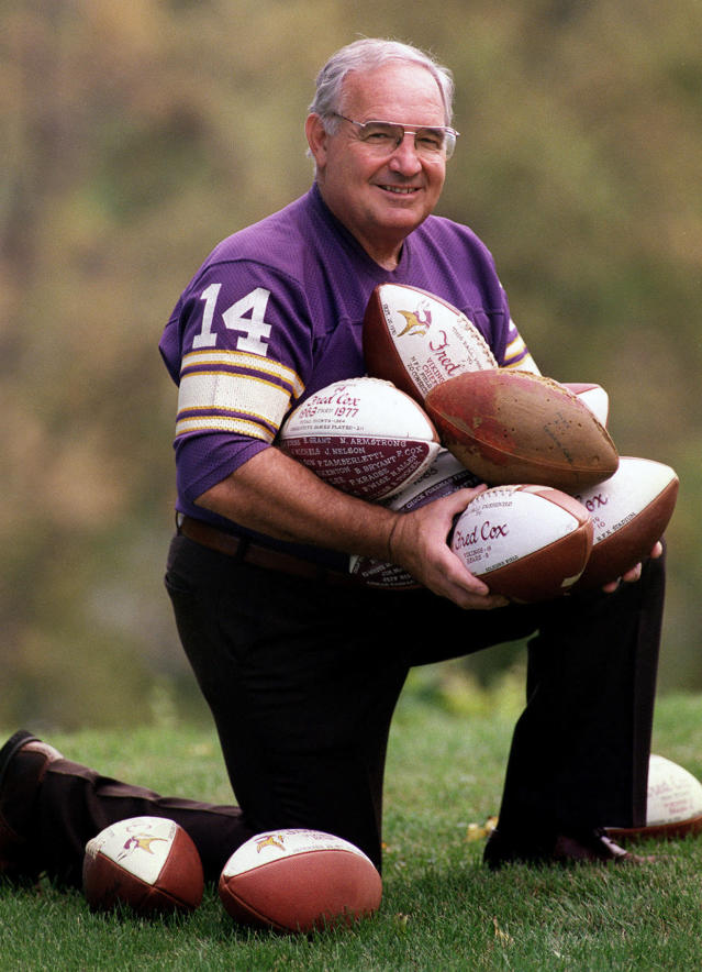 FILE - In this Sept. 1997 file photo, former Minnesota Vikings kicker Fred Cox holds his original Nerf football, among his other souvenir balls, in Monticello, Minn.. Former Minnesota Vikings kicker Fred Cox, the leading scorer in the franchises history and co-creator of the Nerf football, has died. He was 80. The Vikings announced Coxs death Thursday, Nov. 21, 2019. (Jean Pieri/Pioneer Press via AP)