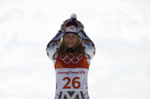 Gold medalist Ester Ledecka, of the Czech Republic, prepares to receive the most unlikely gold medal of the PyeongChang Games. (AP Photo)