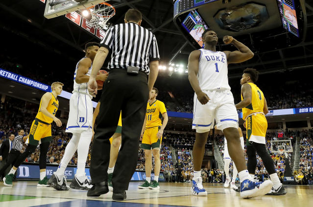 <p>Zion Williamson #1 of the Duke Blue Devils reacts after scoring a basket and drawing a foul against the North Dakota State Bison in the second half during the first round of the 2019 NCAA Men's Basketball Tournament at Colonial Life Arena on March 22, 2019 in Columbia, South Carolina. (Photo by Kevin C. Cox/Getty Images) </p>