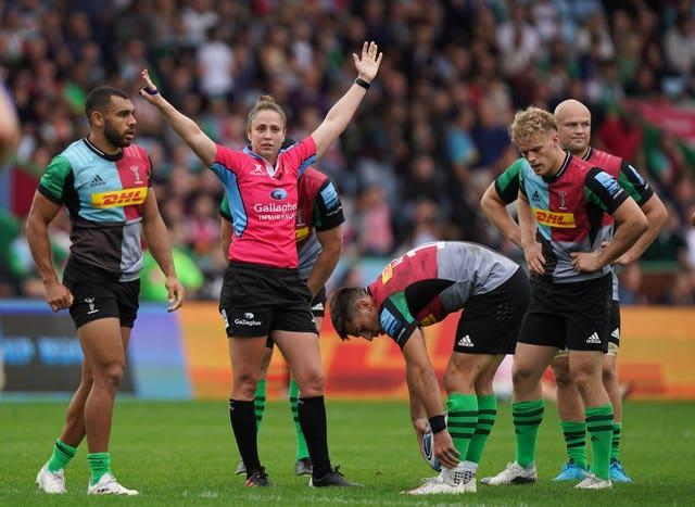Sara Cox (centre) became the first woman to referee a Premiership rugby match when she took charge of Harlequins' clash with Worcester