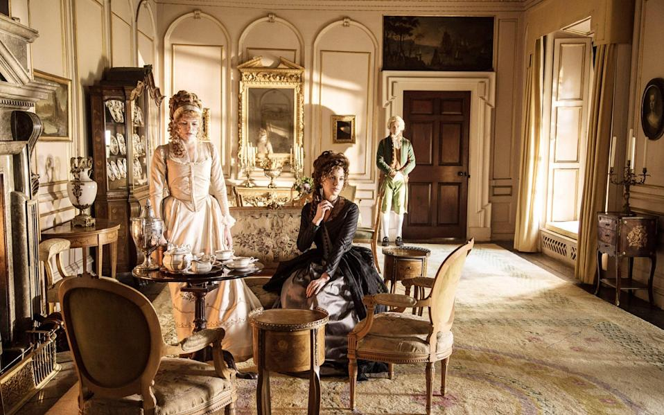 Emma Greenwell and Kate Beckinsale pause for a spot of tea in 2016's Love & Friendship - Everett Collection/Alamy