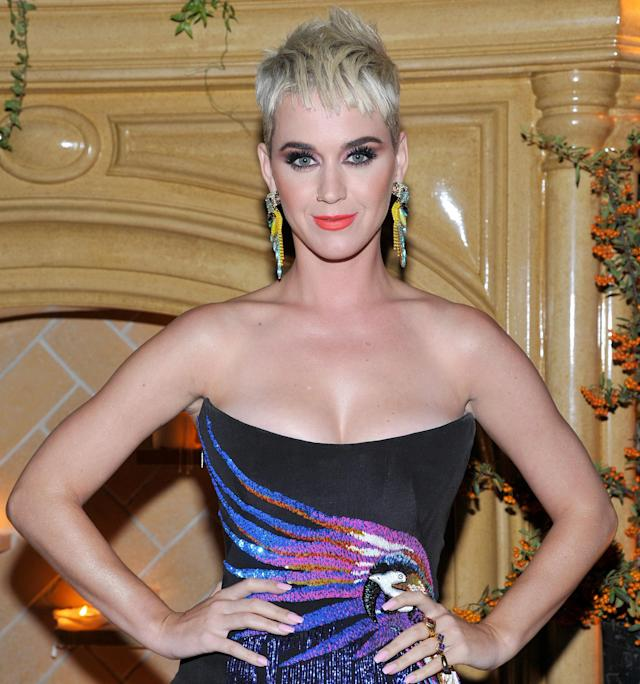 <p>Perry also showed some love at her friend/designer Jeremy Scott's event wearing an edgy pixie and vibrant '80s-inspired makeup. (Photo by John Sciulli/Getty Images for UGG) </p>