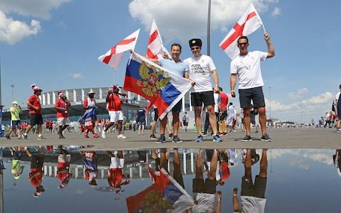 England fans show their support outside the stadium prior to the FIFA World Cup Group G match at the Nizhny Novgorod Stadium - Credit: Owen Humphreys/PA Wire
