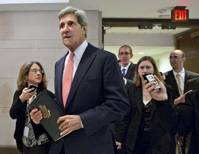 FILE - This Nov. 13, 2012 file photo shows Senate Foreign Relations Committee Chairman, Sen. .John Kerry, D-Mass. pursued by reporters as he arrives for a closed-door meetin on Capitol Hill in Washington. Kerry is angling for the nation's top diplomatic job by being diplomatic. He's asking supporters not to overtly lobby on his behalf, a strategy reflecting both his disdain for Washington's personnel politics and a recognition that if Obama taps Rice instead, Kerry will have to shepherd her difficult nomination through the Senate committee he runs. (AP Photo/J. Scott Applewhite, File)
