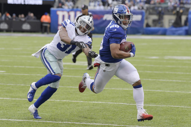 FILE - In this Dec. 30, 2018, file photo, Dallas Cowboys' Byron Jones, left, tries to catch New York Giants' Saquon Barkley during the first half of an NFL football game in East Rutherford, N.J. The dynamic second-year running back is worth the price of admission and can help the team pull off upsets by himself. (AP Photo/Bill Kostroun, File)